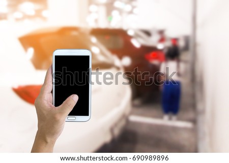Man use mobile phone, blur image of child is at behind the car.The child died a lot with the negligence of the driver. Warning signs behind cars are very necessary.