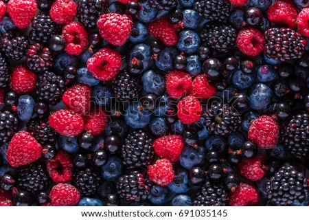 Food background, texture of assorted fresh berries Royalty-Free Stock Photo #691035145