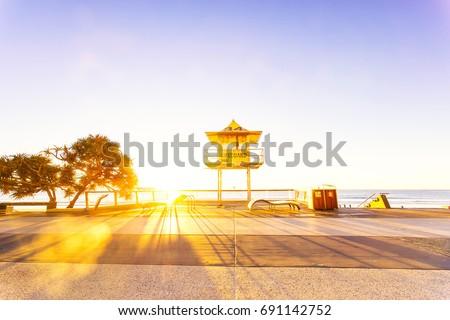 Surfers Paradise lifeguard tower at sunrise #691142752