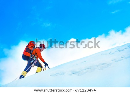 Climber with backpacks reaches the summit of mountain peak. Success, freedom and happiness, achievement in mountains. Active sport concept. #691223494