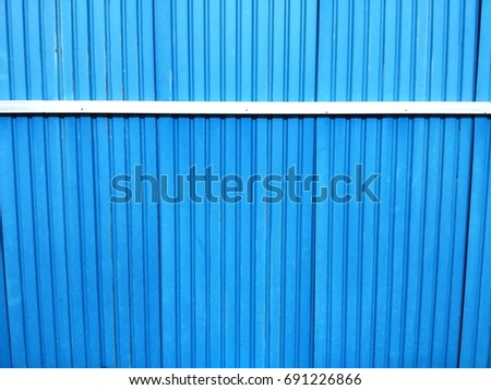 Blue metal sheet with aluminum frame in fence background #691226866