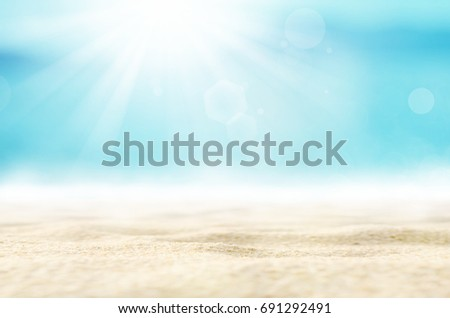 Blur tropical beach with bokeh sun light wave abstract background.  #691292491