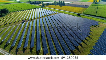 Solar panels in aerial view Royalty-Free Stock Photo #691382056