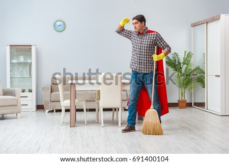 Super hero cleaner working at home #691400104