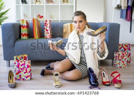 Girl choosing shoes #691423768