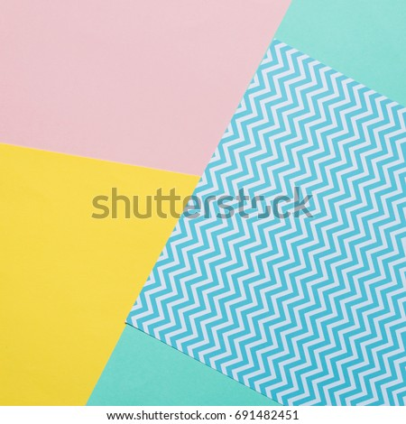 Texture background of fashion pastel colors: pink, yellow, turquoise and geometric pattern papers in minimal concept. Flat lay, Top view. 90s style