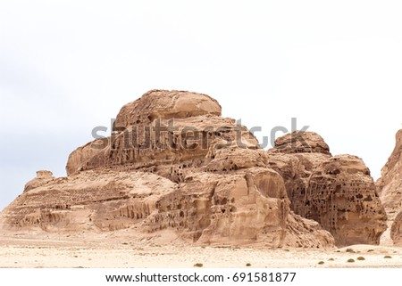 Warm colors background. White Canyon in Sinai. Yellow sandstone textured carved mountain, bright sky. Egyptian desert landscape. #691581877