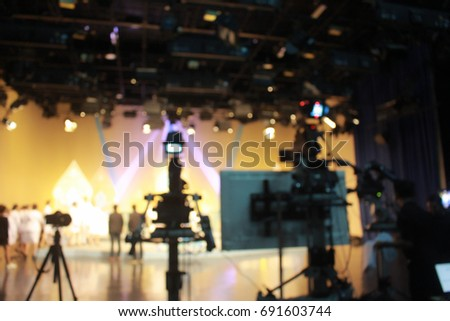 Blurred of  television studio with camera. #691603744