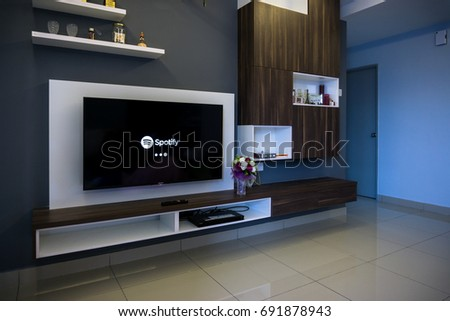 KUALA LUMPUR, MALAYSIA - AUGUST 8TH, 2017 : Modern lifestyle with SONY Android TV to stay connected & browsing media using favourite Apps. Tv display Spotify music apps #691878943