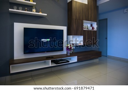 KUALA LUMPUR, MALAYSIA - AUGUST 8TH, 2017 : Modern lifestyle with SONY Android TV to stay connected & browsing media using favourite Apps. Tv display Amazon video apps #691879471