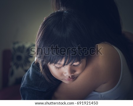 Closeup sad little boy being hugged by his mother at home. Parenthood, Love and togetherness concept. #691921450