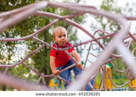 Little boy on the playground #692038285