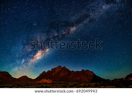 Night landscape with the Milky Way in Namibia in the Spitzkoppe area Royalty-Free Stock Photo #692049943