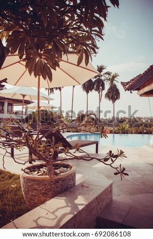 Beautiful hotel  pool in Bali, Indonesia #692086108