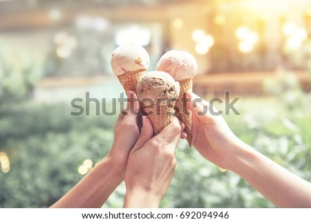 Young woman hands holding ice cream cones on summer #692094946