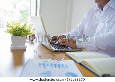 Image of coffee cup and laptop computer, notebook on desk of working business people at meeting #692099830
