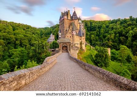 Burg Eltz castle in Rhineland-Palatinate state at sunset, Germany. Construction startedprior to 1157. Royalty-Free Stock Photo #692141062