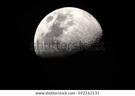 Half Moon Background / The Moon is an astronomical body that orbits planet Earth, being Earth's only permanent natural satellite Royalty-Free Stock Photo #692162131