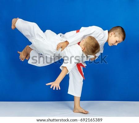 Sportsmens are training judo throws #692165389