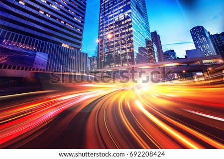 Abstract speed technology background with Hong Kong City night scenes Royalty-Free Stock Photo #692208424