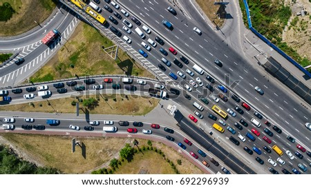 Aerial top view of road junction from above, automobile traffic and jam of many cars, transportation concept  Royalty-Free Stock Photo #692296939