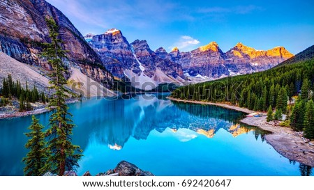 Blue water with mountains  Royalty-Free Stock Photo #692420647