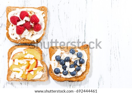 sweet toast with different toppings on white wooden table, top view #692444461