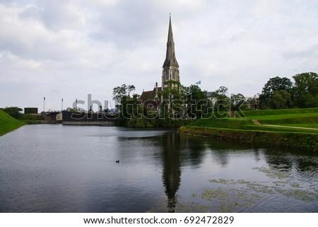 Beautiful reflection view of St Alban's Church, Copenhagen, Denmark   #692472829