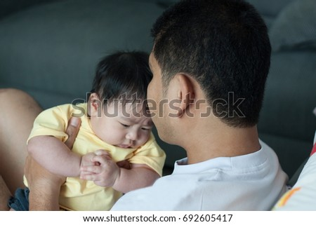 Baby happiness with father. #692605417