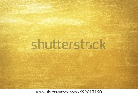 Shiny yellow leaf gold foil texture background #692617150