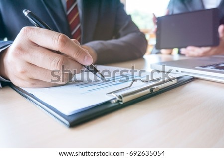 Man Completing Application Form during job interview. human resources concept #692635054