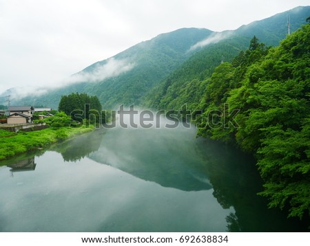 A mountain reflected on the surface of the water #692638834