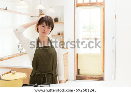 young asian woman in the kitchen #692681245