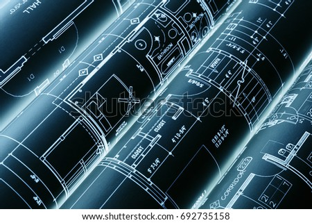 House blueprints, blue print style floor plans on architects desk, blueprint of a house from a high angle, engineering drawings blueprints and house plan blueprints rolled up Royalty-Free Stock Photo #692735158