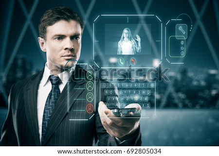 Man in blurry interior communicating with young woman waving at him through abstract futuristic screen hologram. 3D Rendering   #692805034
