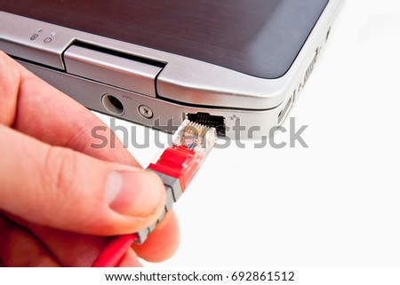 Connecting network cable to laptop #692861512
