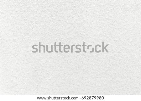 Texture of old light white paper background, closeup. Structure of dense cream cardboard. Royalty-Free Stock Photo #692879980