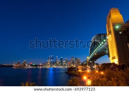 Sydney Harbour Bridge and Sydney skyline at night #692977123