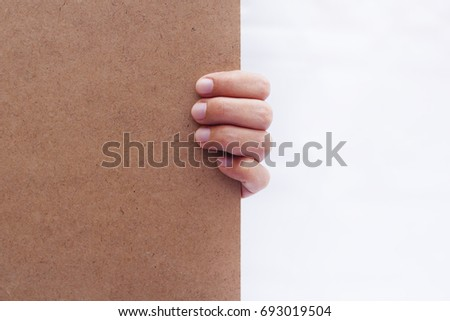 Hand Holding Blank Board Over White Background #693019504