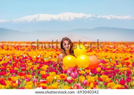Girl in tulip field  #693040342