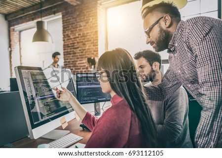 Developing programming and coding technologies. Website design. Programmer working in a software develop company office. Royalty-Free Stock Photo #693112105