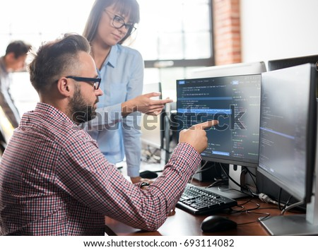 Developing programming and coding technologies. Website design. Programmer working in a software develop company office. #693114082