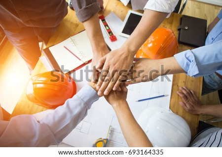 Power of cooperation in the construction business.To succeed in developing sustainable partnerships. Royalty-Free Stock Photo #693164335