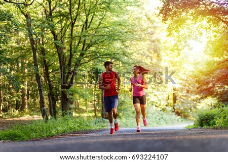Young couple running in nature. #693224107