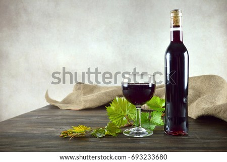 Red wine bottle and glass of wine  #693233680