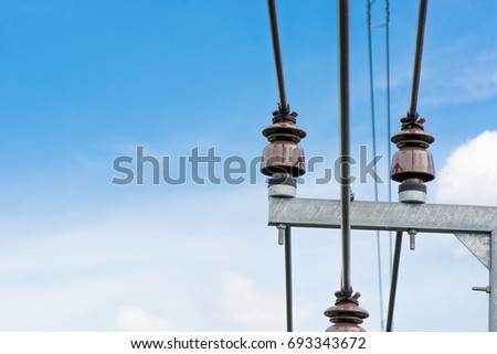 Close up electric post with blue sky backgrond #693343672