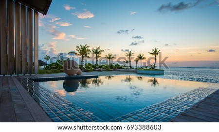 Luxury Swimming pool in front of beach #693388603