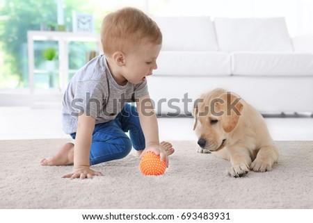 Cute child with Labrador Retriever at home #693483931
