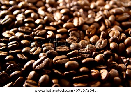 coffee background Coffee is a brewed drink prepared from roasted coffee beans #693572545