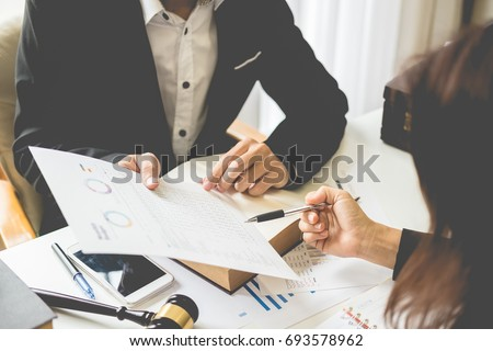 Client and lawyer have a sit down face to face meeting to discuss the legal options available Royalty-Free Stock Photo #693578962